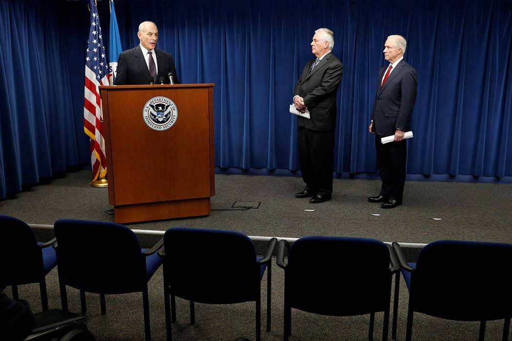 Homeland Security Secretary John Kelly, left, Secretary of State Rex Tillerson and Attorney General Jeff Sessions deliver remarks on issues related to visas and travel after President Donald Trump ...