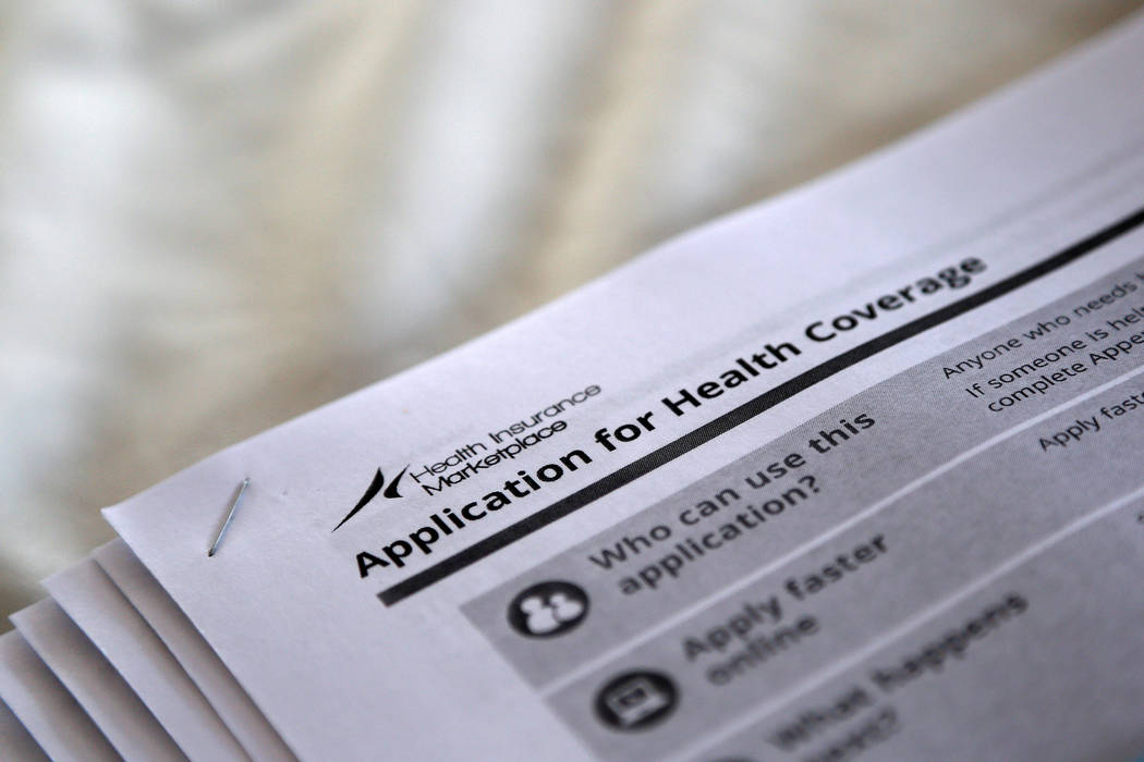 """The federal government forms for applying for health coverage are seen at a rally held by supporters of the Affordable Care Act, widely referred to as """"Obamacare,"""" outside the Jackson-Hinds Compre ..."""