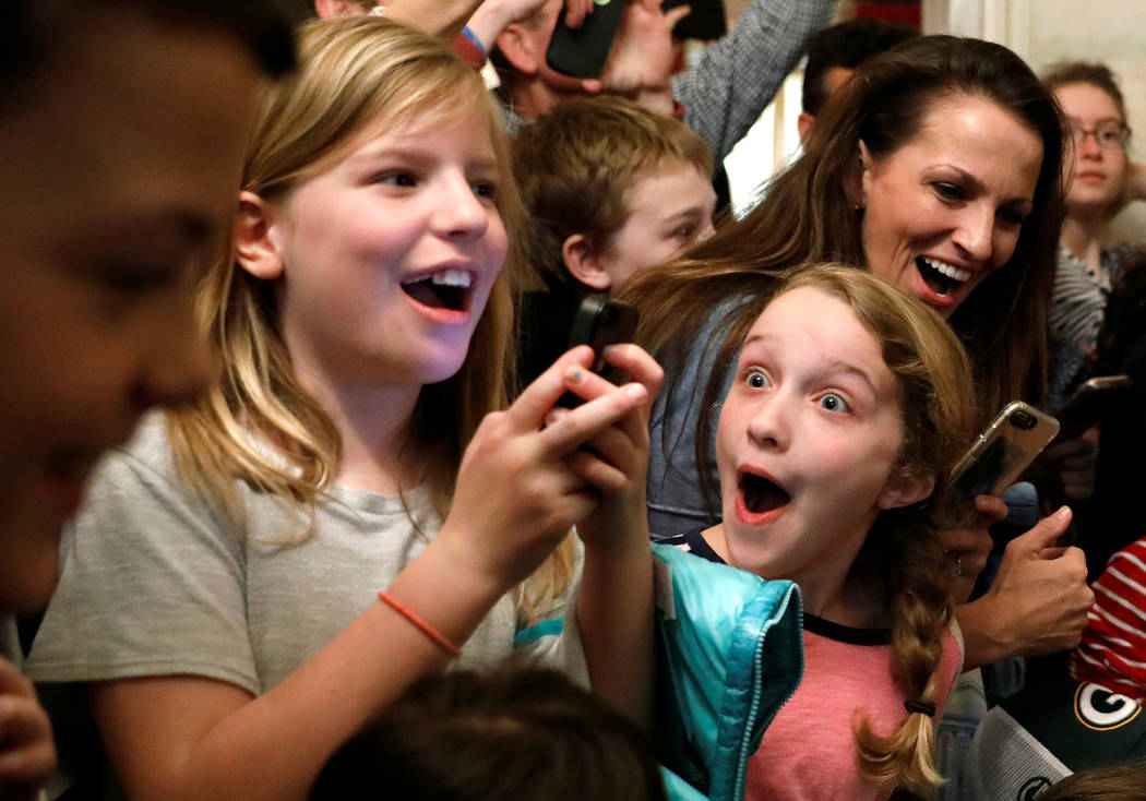 A young girl reacts after President Donald Trump made a surprise appearance in front of her White House tour group in Washington, March 7, 2017. (Kevin Lamarque/Reuters)