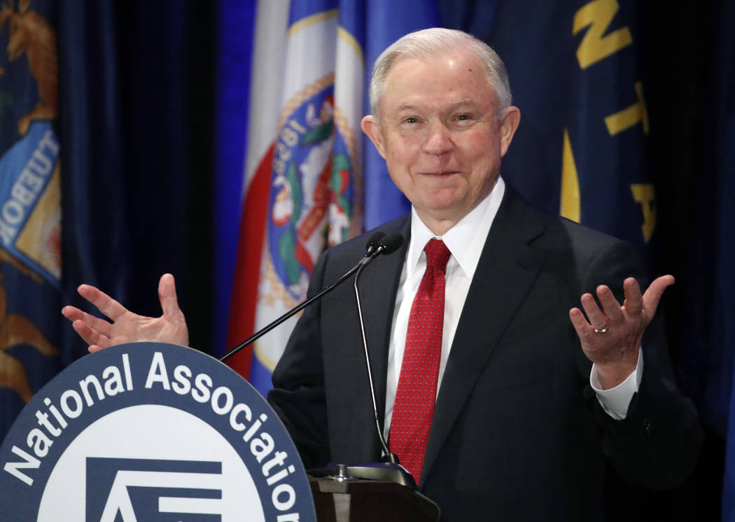 Attorney General Jeff Sessions pauses Feb. 28, 2017, while speaking at the National Association of Attorneys General annual winter meeting in Washington. Sessions had two conversations with the Ru ...