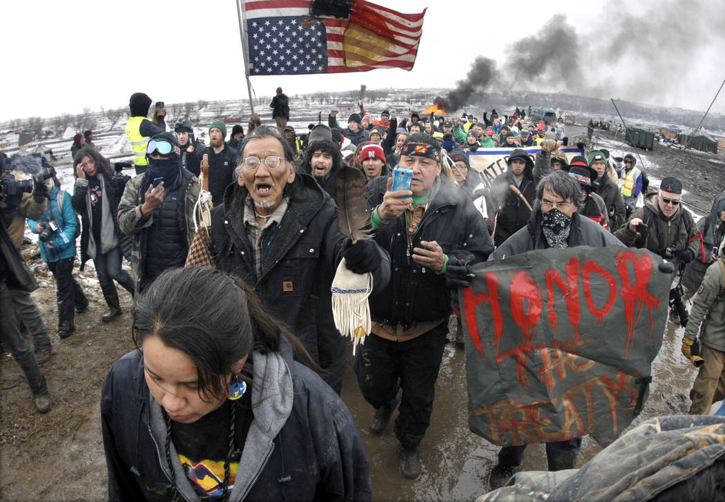 A large crowd representing a majority of the remaining Dakota Access Pipeline protesters marches out of the Oceti Sakowin camp Feb. 22, 2017, before the 2 p.m. local time deadline set for evacuati ...