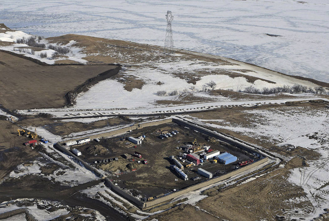 This Feb. 13, 2017, aerial file photo shows the site where the final phase of the Dakota Access Pipeline will take place with boring equipment routing the pipeline underground and across Lake Oahe ...