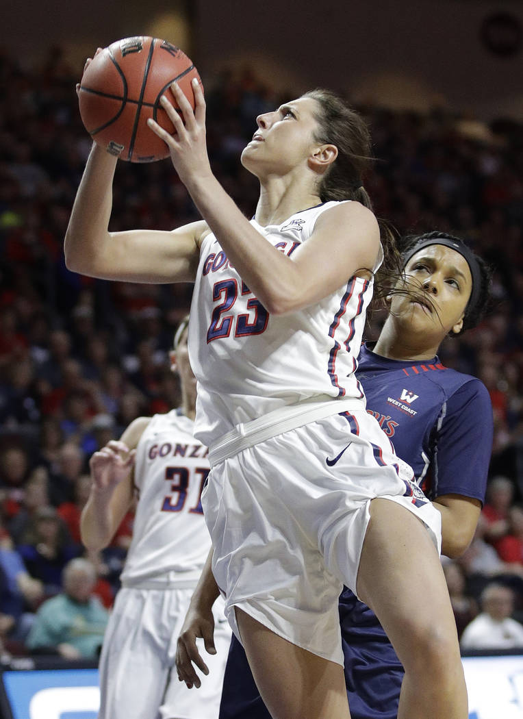 Gonzaga's Kiara Kudron shoots around Saint Mary's Samira McDonald in the first half of an NCAA college basketball game in the championship of the West Coast Conference tournament, Tuesday, March 7 ...