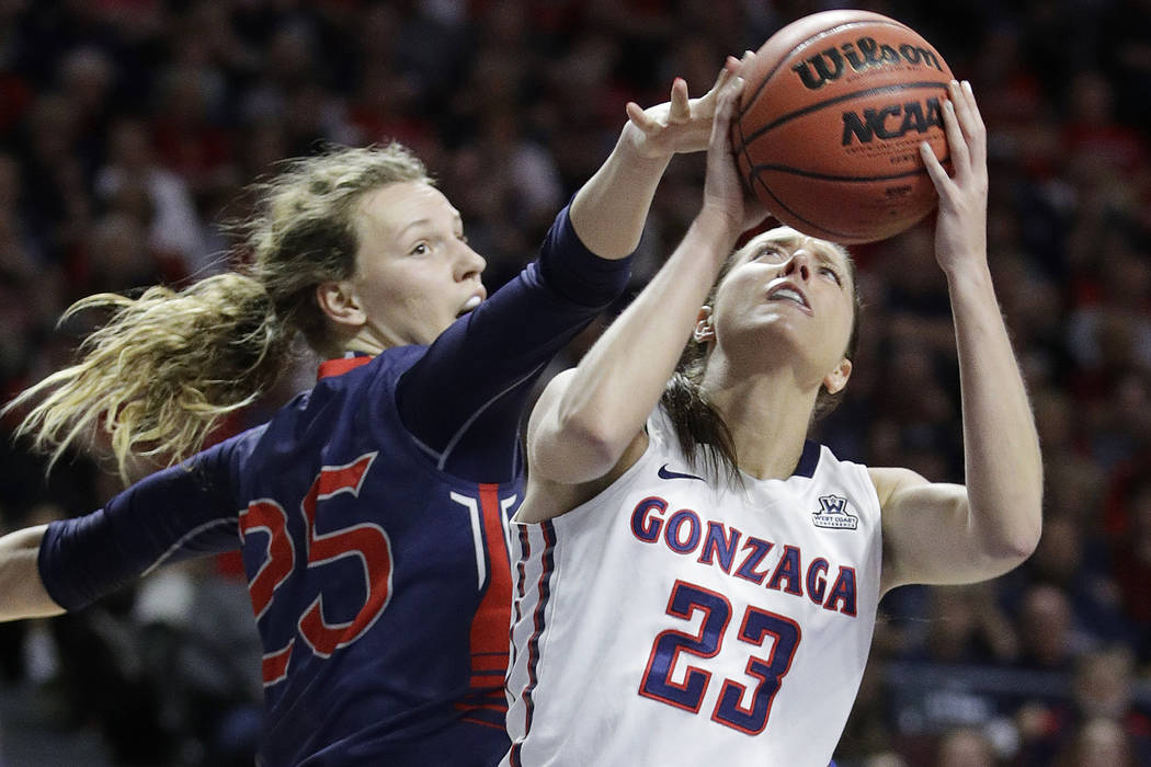 Gonzaga's Kiara Kudron, right, shoots over Saint Mary's Megan McKay in the first half of an NCAA college basketball game during the championship of the West Coast Conference tournament, Tuesday, M ...
