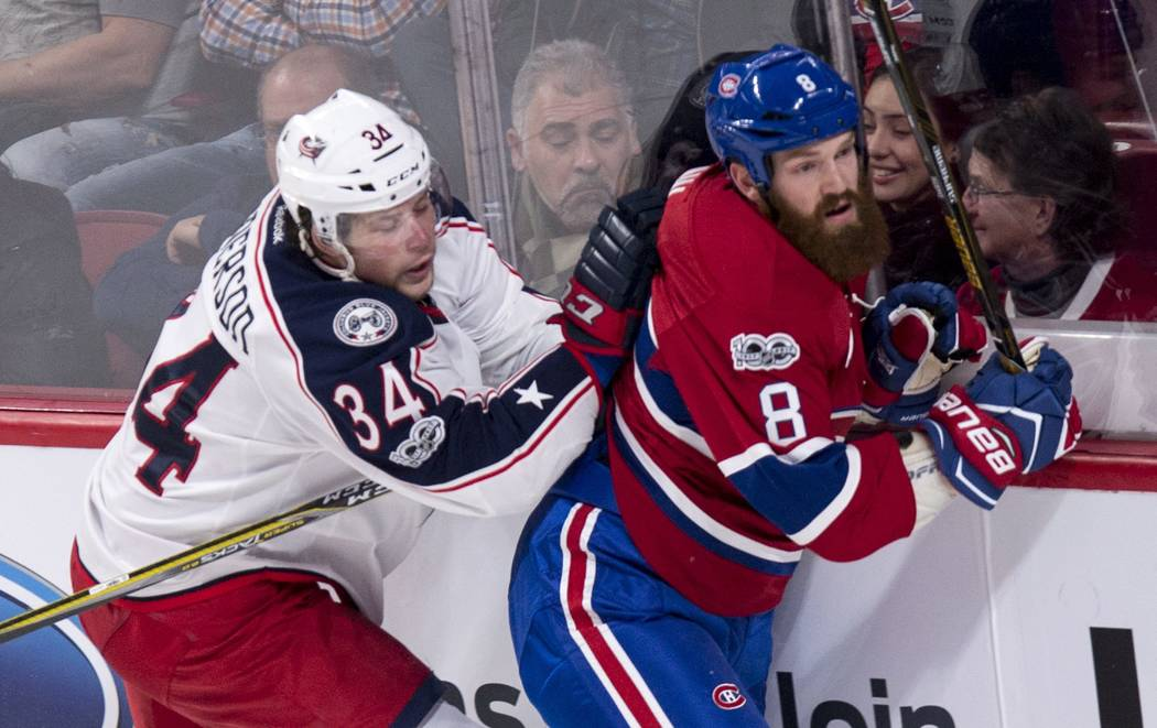 Montreal Canadiens' Jordie Benn is checked by Columbus Blue Jackets' Josh Anderson during the first period of an NHL hockey game, Tuesday, Feb. 28, 2017 in Montreal. (Paul Chiasson/The Canadian Pr ...