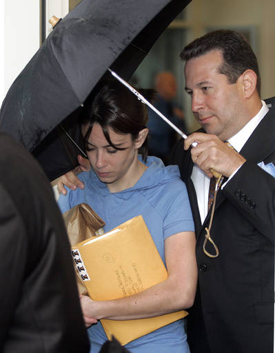 FILE- In this Aug. 21, 2008, file photo, Casey Anthony, mother of missing toddler Caylee, is escorted from the Orange County Florida jail by her attorney Jose Baez. Almost nine years later, Anthon ...