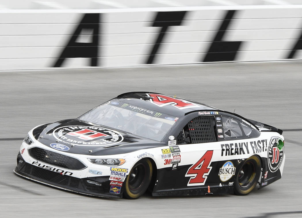 A car driven by Kevin Harvick comes out of Turn 4 during a NASCAR Monster Cup series auto race at Atlanta Motor Speedway in Hampton, Ga., Sunday, March 5, 2017. (AP Photo/John Amis)