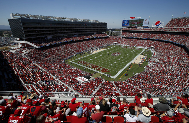 FILE - In this Aug. 17, 2014, file photo, fans watch as the San Francisco 49ers play the Denver Broncos during the first quarter of an NFL preseason football game at Levi's Stadium in Santa Clara, ...