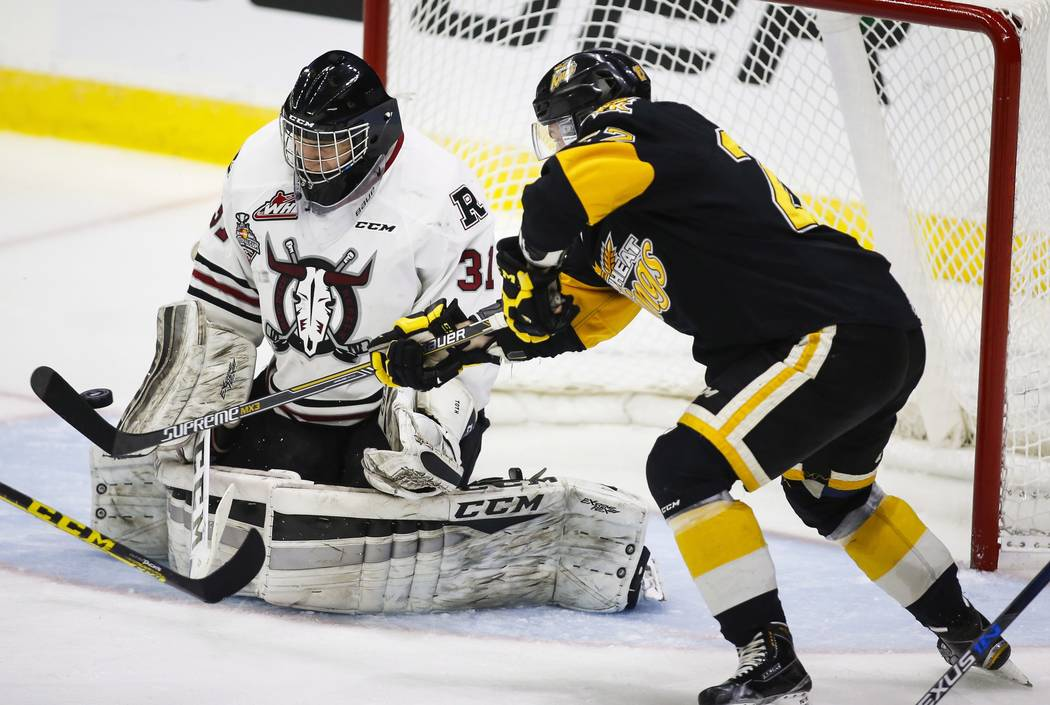 Brandon Wheat Kings' Reid Duke, right, tries to tip the puck past Red Deer Rebels goalie Rylan Toth during second period CHL Memorial Cup hockey action in Red Deer, Wednesday, May 25, 2016.(Jeff M ...