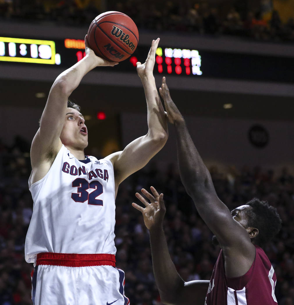 Gonzaga forward Zach Collins (32) shoots over Santa Clara center Emmanuel Ndumanya (50) during a West Coast Conference basketball tournament game at the Orleans Arena in Las Vegas on Monday, March ...