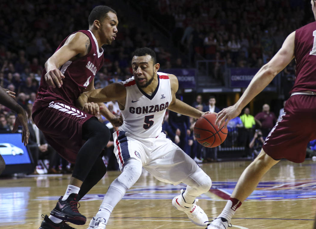 Gonzaga guard Nigel Williams-Goss (5) looks to get past Santa Clara forward Jarvis Pugh (4) during a West Coast Conference basketball tournament game at the Orleans Arena in Las Vegas on Monday, M ...