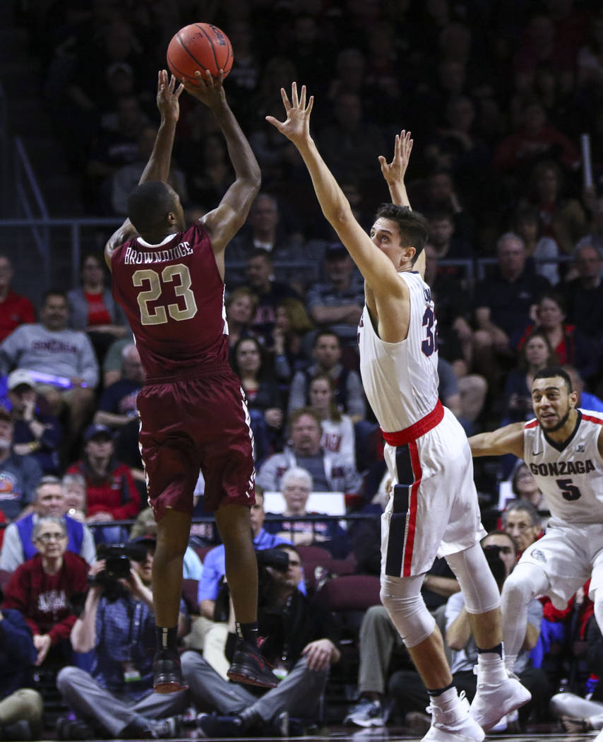Santa Clara guard Jared Brownridge (23) shoots over Gonzaga forward Zach Collins (32) during a West Coast Conference basketball tournament game at the Orleans Arena in Las Vegas on Monday, March 6 ...