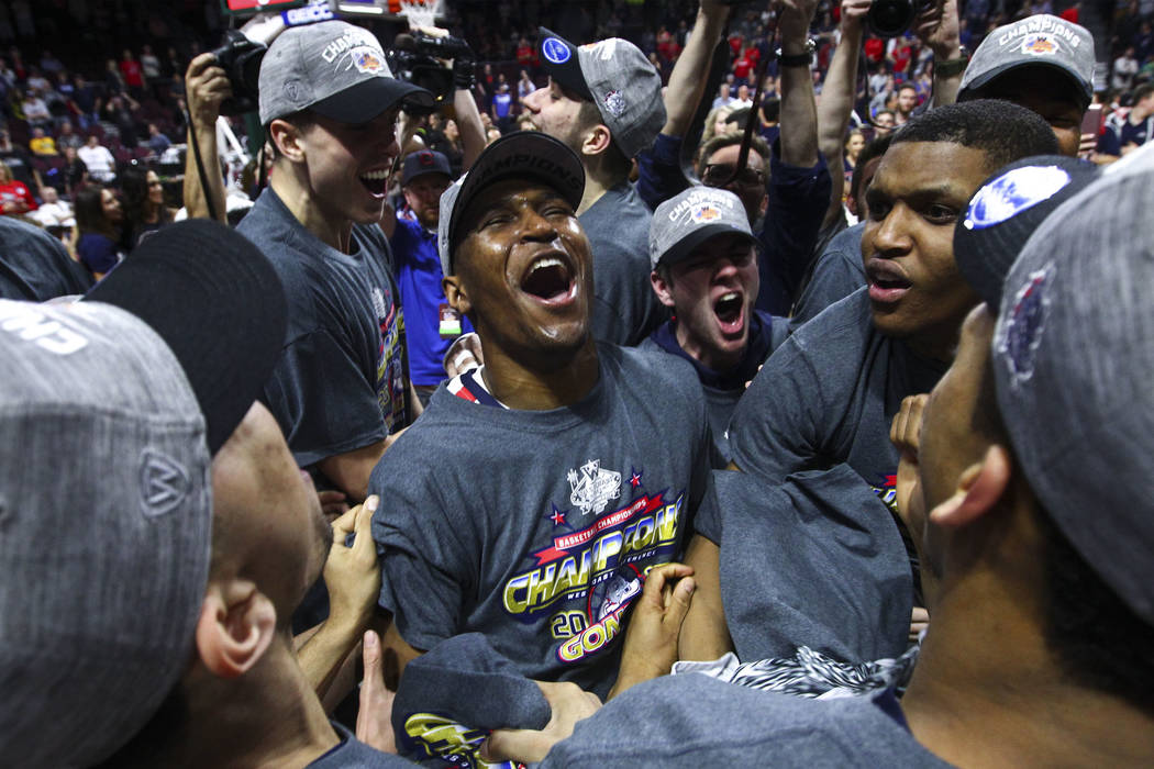 Gonzaga players celebrate after defeating St. Mary's 74-56 in the West Coast Conference basketball championship game at the Orleans Arena in Las Vegas on Tuesday, March 7, 2017. (Chase Stevens/Las ...
