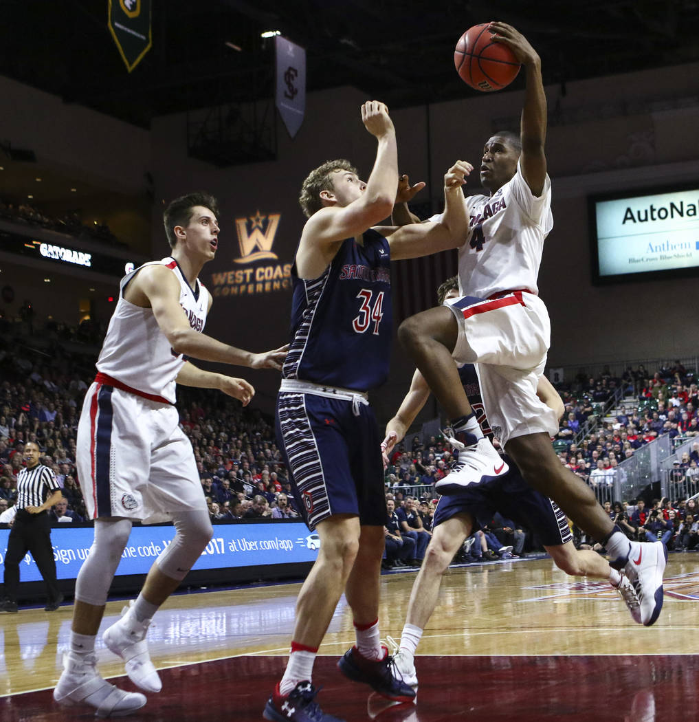 Gonzaga guard Jordan Mathews (4) drives to the basket against St. Mary's center Jock Landale (34) during the West Coast Conference basketball championship game at the Orleans Arena in Las Vegas on ...