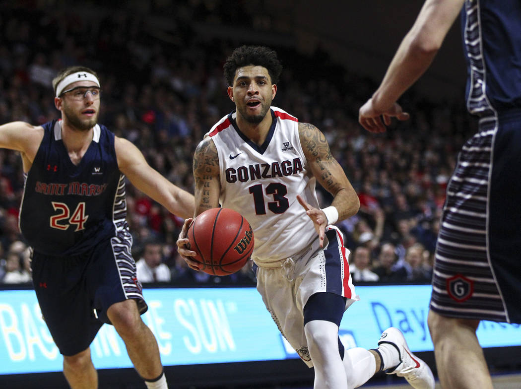 Gonzaga guard Josh Perkins (13) drives past St. Mary's forward Calvin Hermanson (24) during the West Coast Conference basketball championship game at the Orleans Arena in Las Vegas on Tuesday, Mar ...