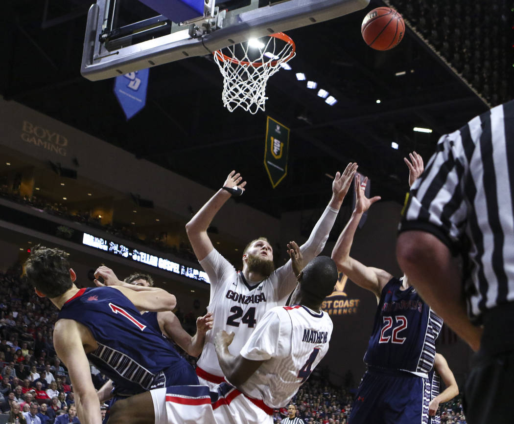 Gonzaga and St. Mary's players go up for a rebound during the West Coast Conference basketball championship game at the Orleans Arena in Las Vegas on Tuesday, March 7, 2017. (Chase Stevens/Las Veg ...