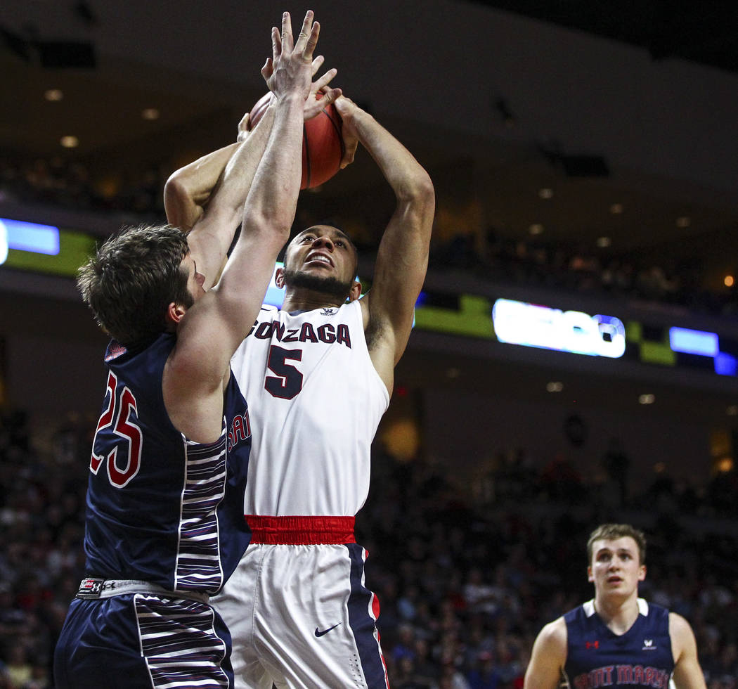 Gonzaga guard Nigel Williams-Goss (5) goes to the basket against St. Mary's guard Joe Rahon (25) during the West Coast Conference basketball championship game at the Orleans Arena in Las Vegas on  ...