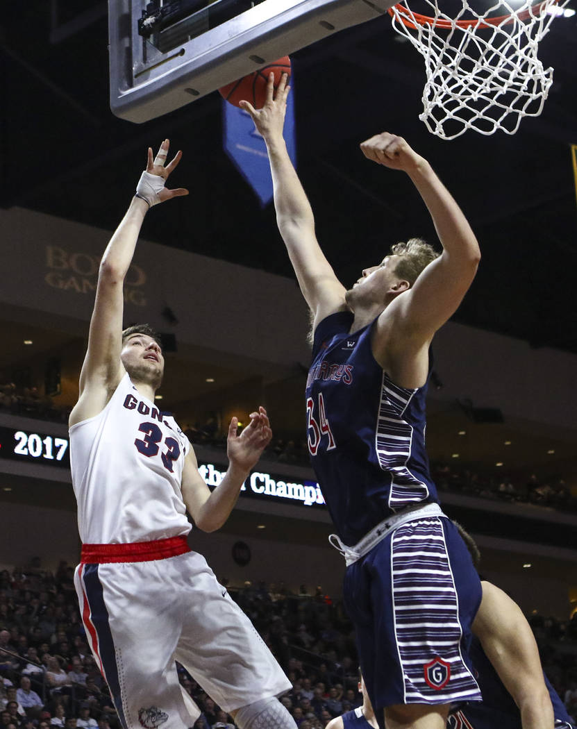 St. Mary's center Jock Landale (34) blocks a shot from Gonzaga forward Killian Tillie (33) during the West Coast Conference basketball championship game at the Orleans Arena in Las Vegas on Tuesda ...