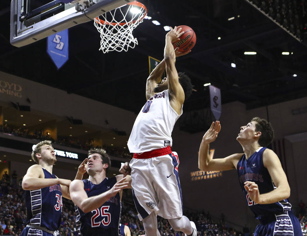 Gonzaga guard Silas Melson (0) sends up a shot against St. Mary's during the West Coast Conference basketball championship game at the Orleans Arena in Las Vegas on Tuesday, March 7, 2017. (Chase  ...