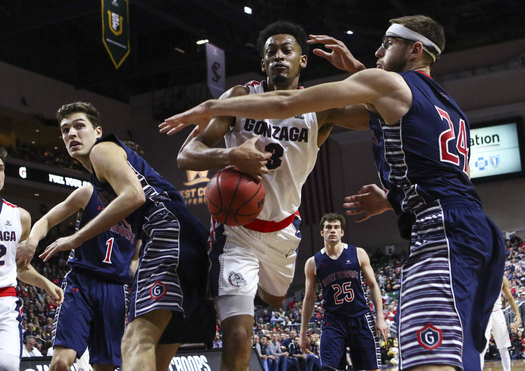 Gonzaga forward Johnathan Williams (3) loses control of a rebound as St. Mary's forward Calvin Hermanson (24) defends during the West Coast Conference basketball championship game at the Orleans A ...