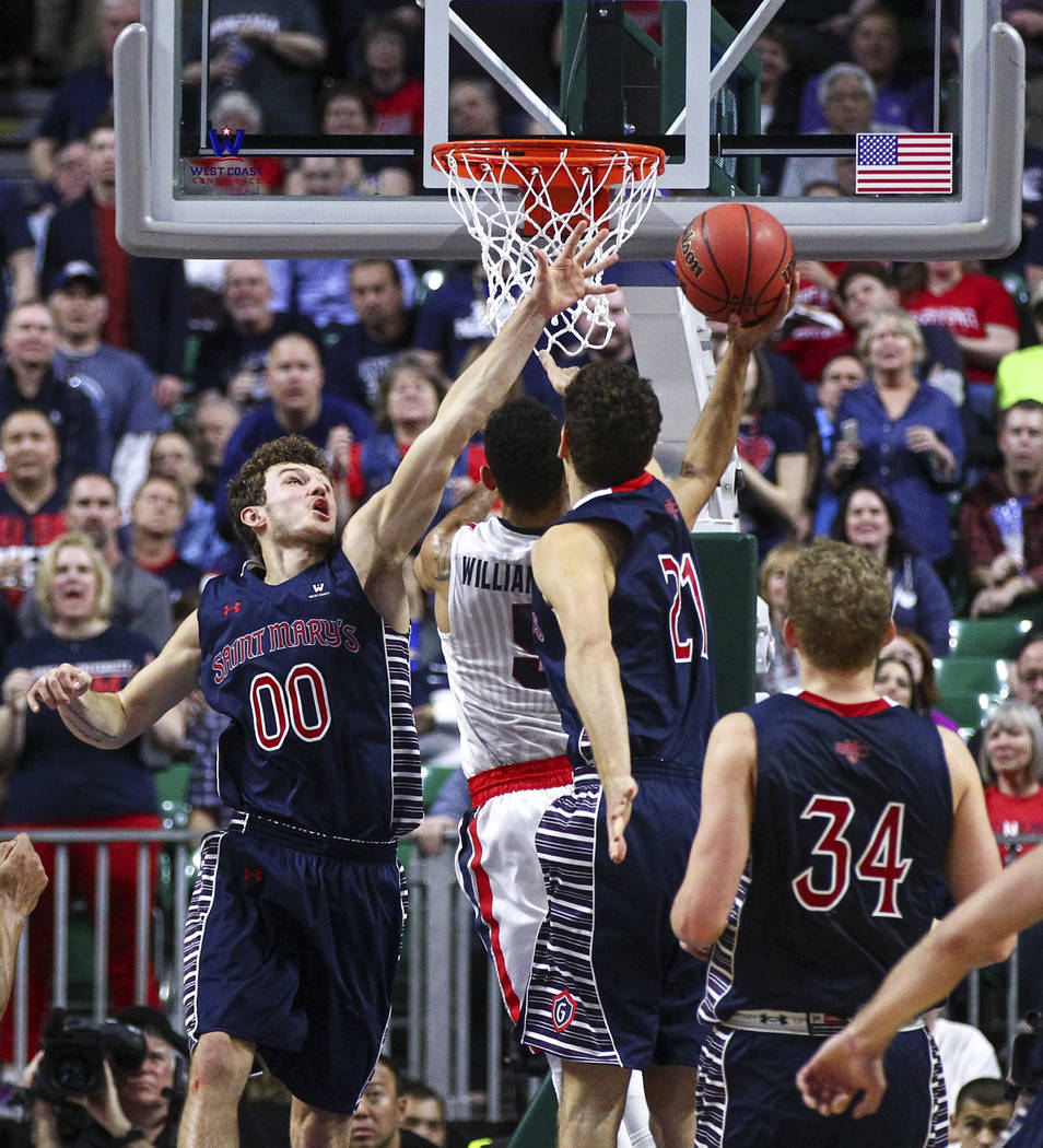 Gonzaga guard Nigel Williams-Goss (5) goes up to score between St. Mary's guard Tanner Krebs (00) and St. Mary's center Evan Fitzner (21) during the West Coast Conference basketball championship g ...