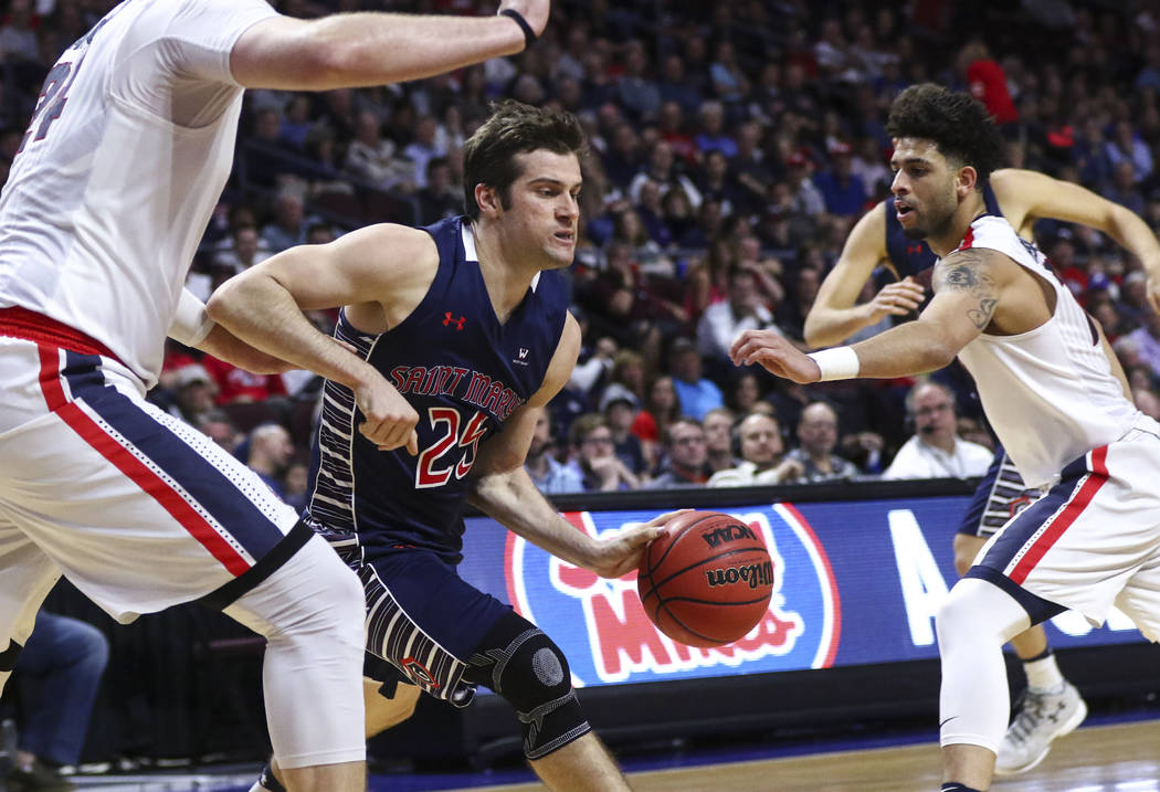 St. Mary's guard Joe Rahon (25) drives to the basket against Gonzaga during the West Coast Conference basketball championship game at the Orleans Arena in Las Vegas on Tuesday, March 7, 2017. (Cha ...