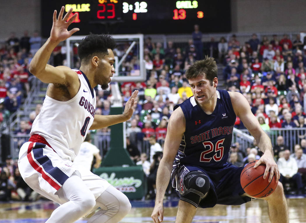St. Mary's guard Joe Rahon (25) drives against Gonzaga guard Silas Melson (0) during the West Coast Conference basketball championship game at the Orleans Arena in Las Vegas on Tuesday, March 7, 2 ...