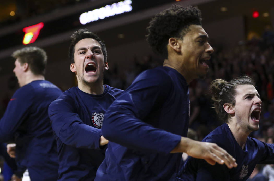 Gonzaga players celebrate a dunk by forward Johnathan Williams (3) during the West Coast Conference basketball championship game against St. Mary's at the Orleans Arena in Las Vegas on Tuesday, Ma ...