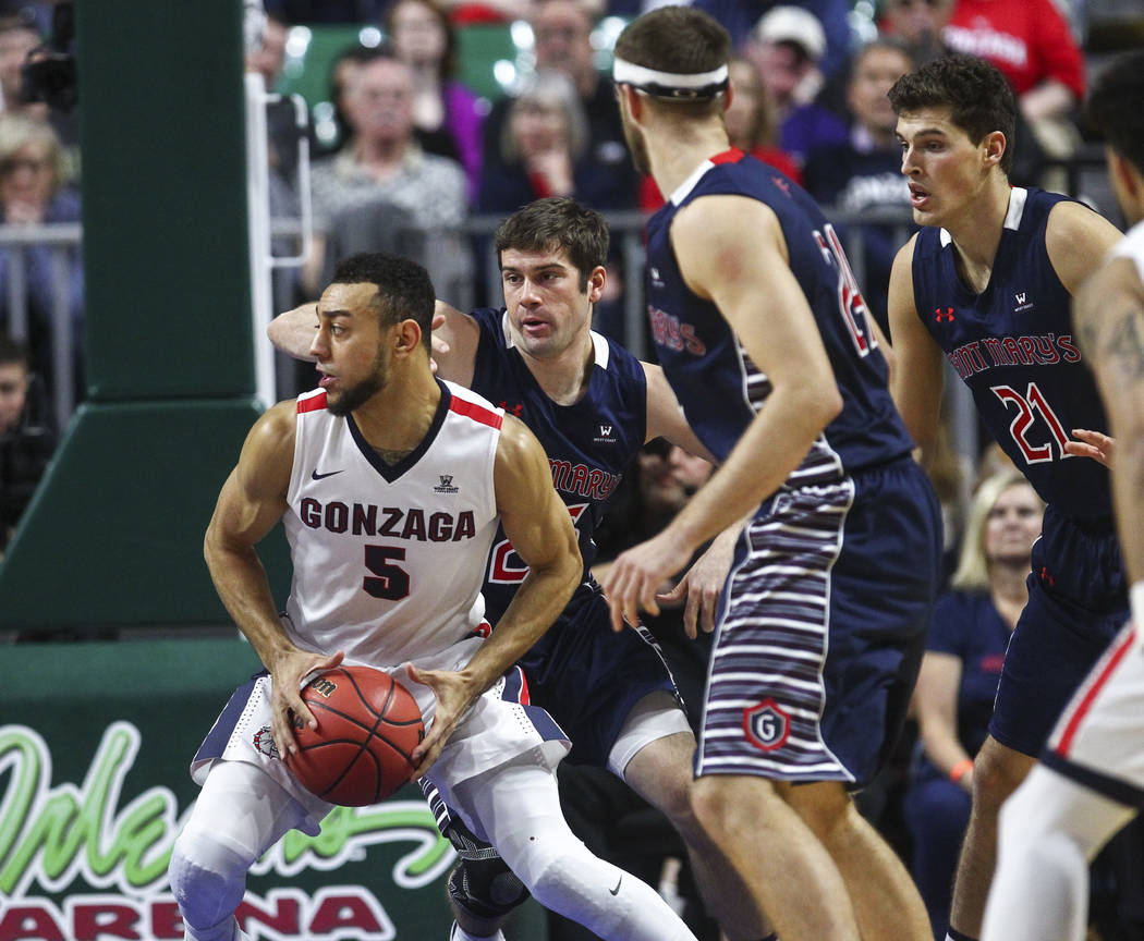 Gonzaga guard Nigel Williams-Goss (5) drives to the basket past St. Mary's defenders during the West Coast Conference basketball championship game at the Orleans Arena in Las Vegas on Tuesday, Mar ...