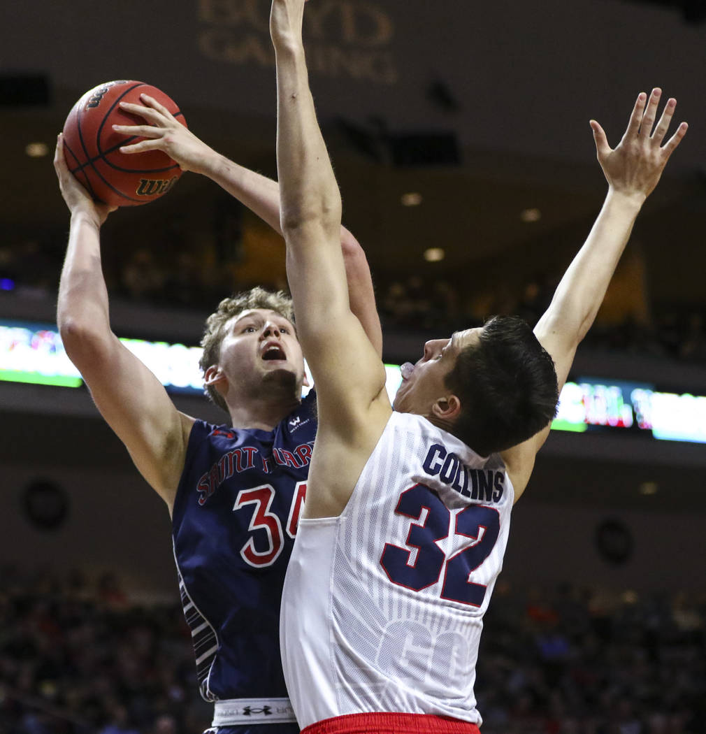 St. Mary's center Jock Landale (34) attempts to shoot over Gonzaga forward Zach Collins (32) during the West Coast Conference basketball championship game at the Orleans Arena in Las Vegas on Tues ...
