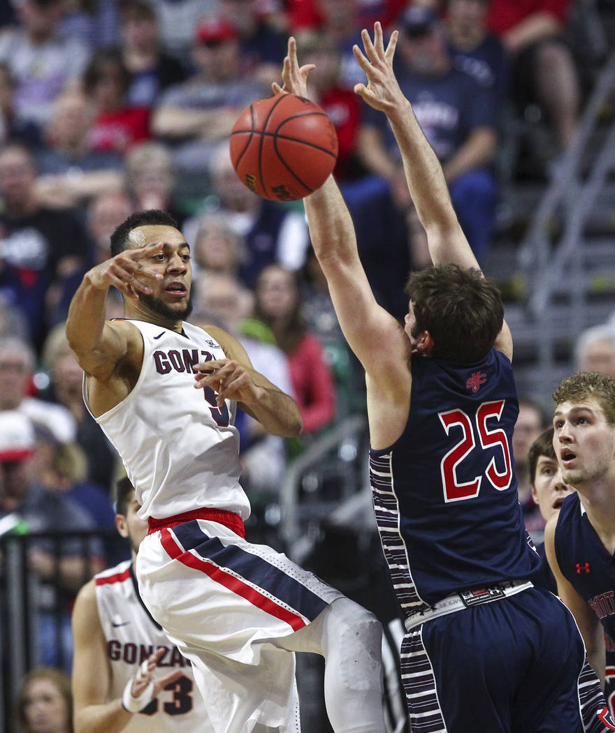 Gonzaga guard Nigel Williams-Goss (5) passes the ball over St. Mary's guard Joe Rahon (25) during the West Coast Conference basketball championship game at the Orleans Arena in Las Vegas on Tuesda ...