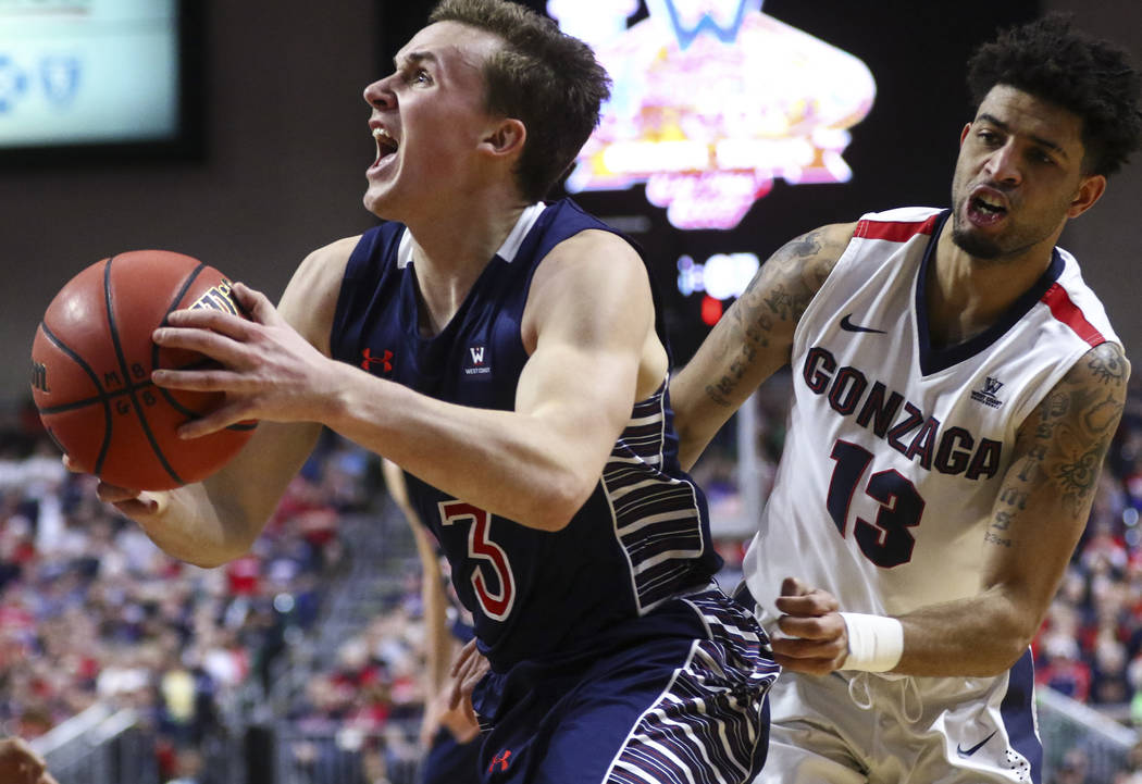 St. Mary's guard Emmett Naar (3) drives to the basket past Gonzaga guard Josh Perkins (13) during the West Coast Conference basketball championship game at the Orleans Arena in Las Vegas on Tuesda ...