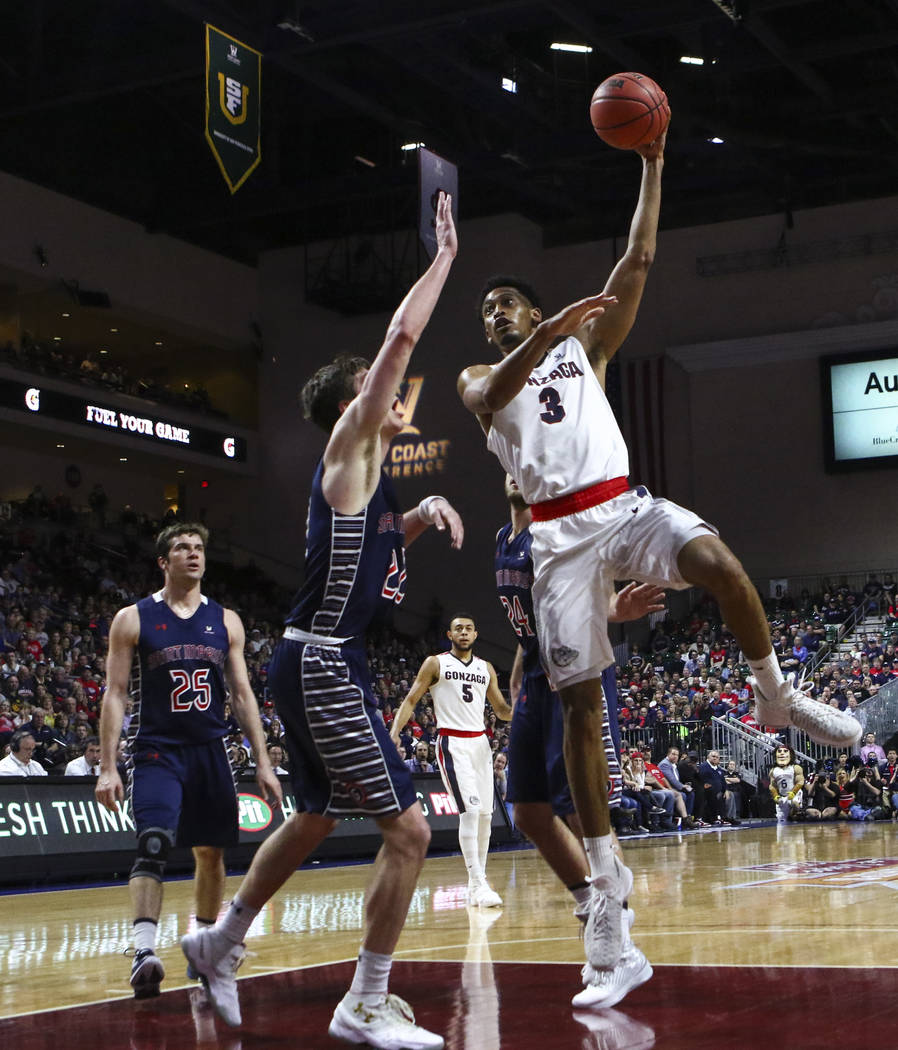 Gonzaga forward Johnathan Williams (3) sends up a shot over St. Mary's forward Dane Pineau (22) during the West Coast Conference basketball championship game at the Orleans Arena in Las Vegas on T ...