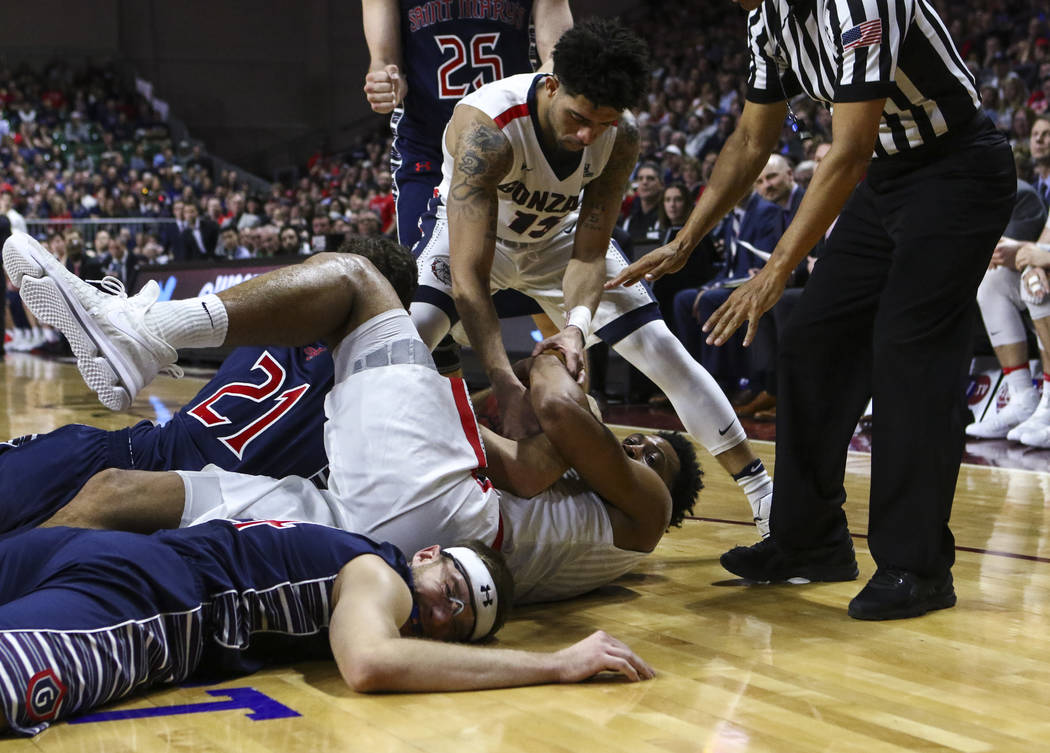 Gonzaga forward Johnathan Williams (3) holds on to a rebound after falling to the floor during the West Coast Conference basketball championship game against St. Mary's  at the Orleans Arena in La ...