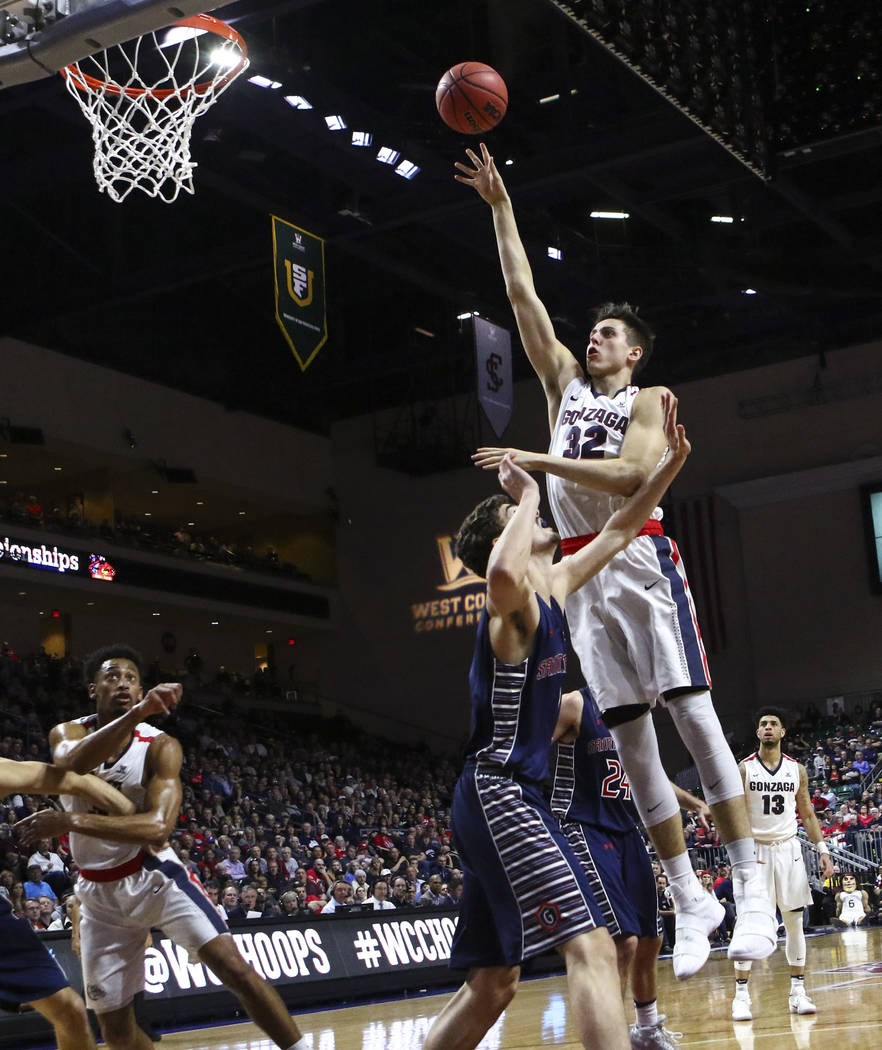Gonzaga forward Zach Collins (32) shoots over St. Mary's during the West Coast Conference basketball championship game at the Orleans Arena in Las Vegas on Tuesday, March 7, 2017. (Chase Stevens/L ...