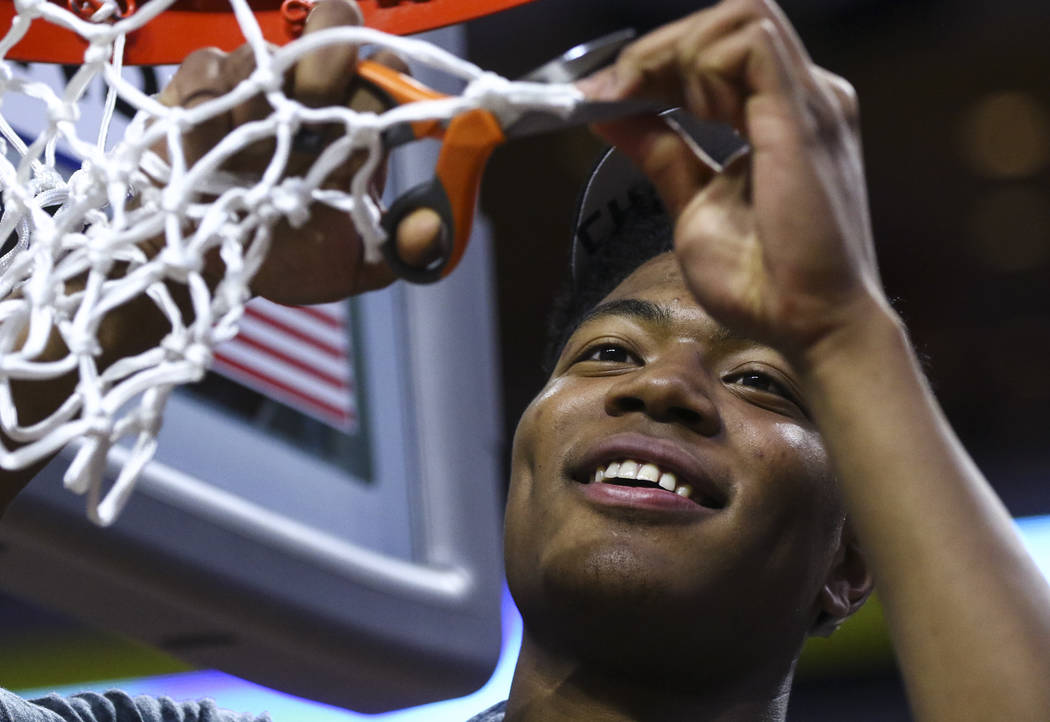 Gonzaga forward Rui Hachimura (21) cuts down the net during the West Coast Conference basketball championship game at the Orleans Arena in Las Vegas on Tuesday, March 7, 2017. (Chase Stevens/Las V ...