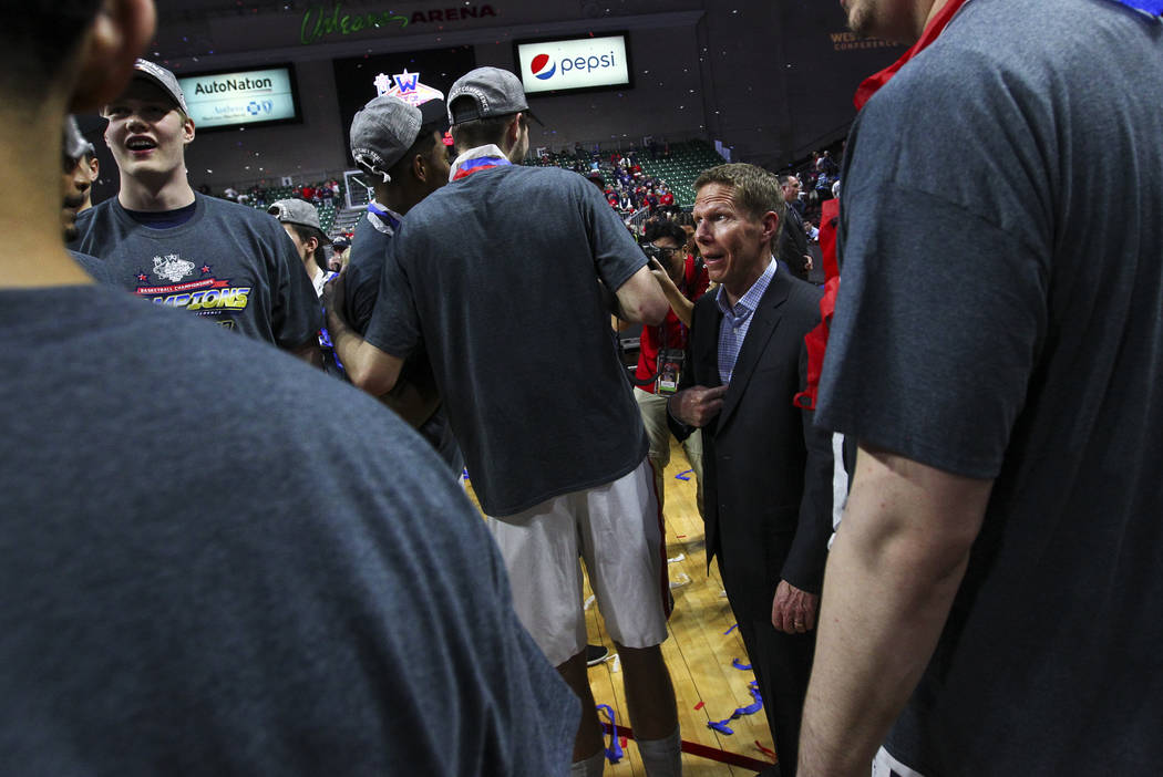 Gonzaga head coach Mark Few jokes with his players after the team defeated St. Mary's 74-56 in the West Coast Conference basketball championship game at the Orleans Arena in Las Vegas on Tuesday,  ...