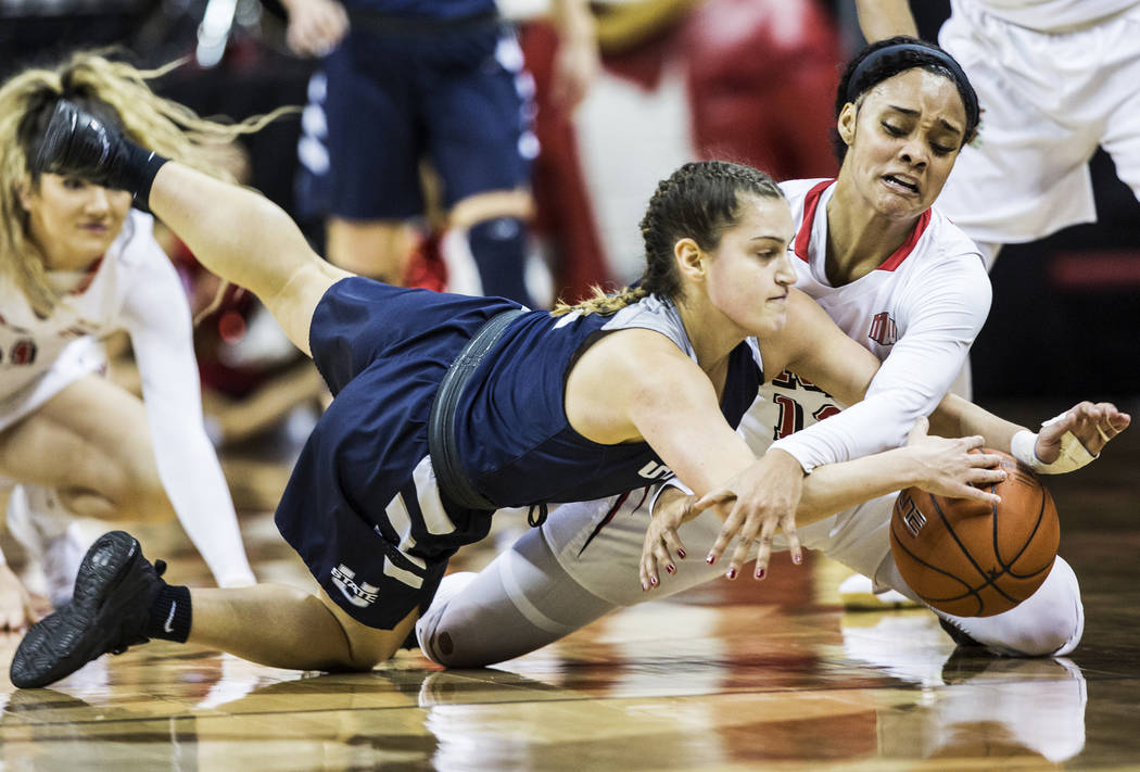 UNLV's Dakota Gonzalez (12) fights for a loose ball with  Utah State's Eliza West (1) during the second round of the Mountain West tournament on Tuesday, March 7, 2017, at Thomas & Mack Center ...