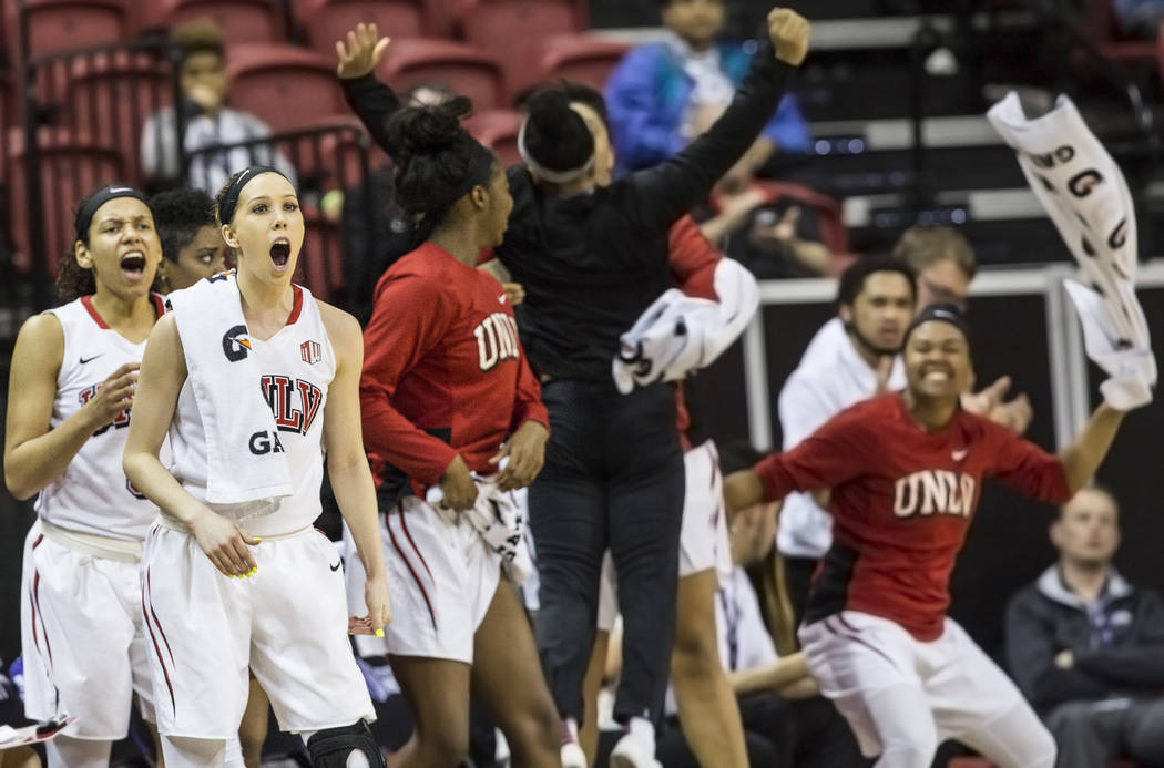UNLV's Brooke Johnson (2) and the Rebel bench erupt after a score during the second round of the Mountain West tournament on Tuesday, March 7, 2017, at Thomas & Mack Center, in Las Vegas.  (Be ...