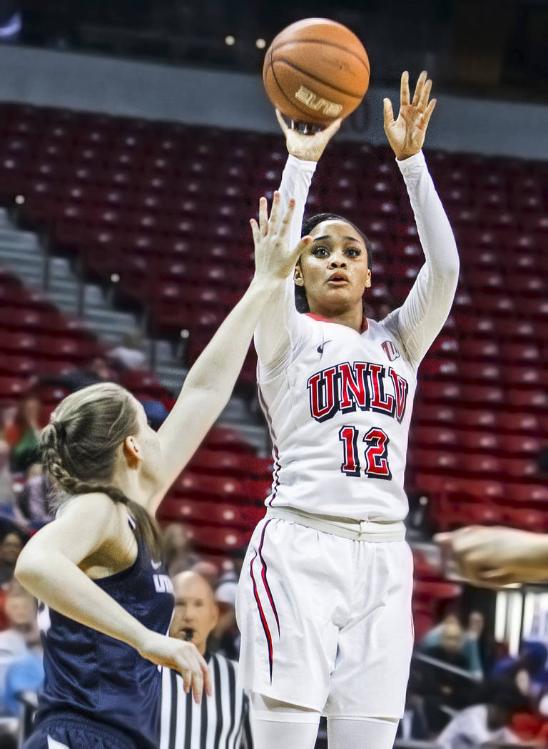 UNLV's Dakota Gonzalez (12) shoots a jump shot over Utah State's Rachel Brewster (22) during the second round of the Mountain West tournament on Tuesday, March 7, 2017, at Thomas & Mack Center ...