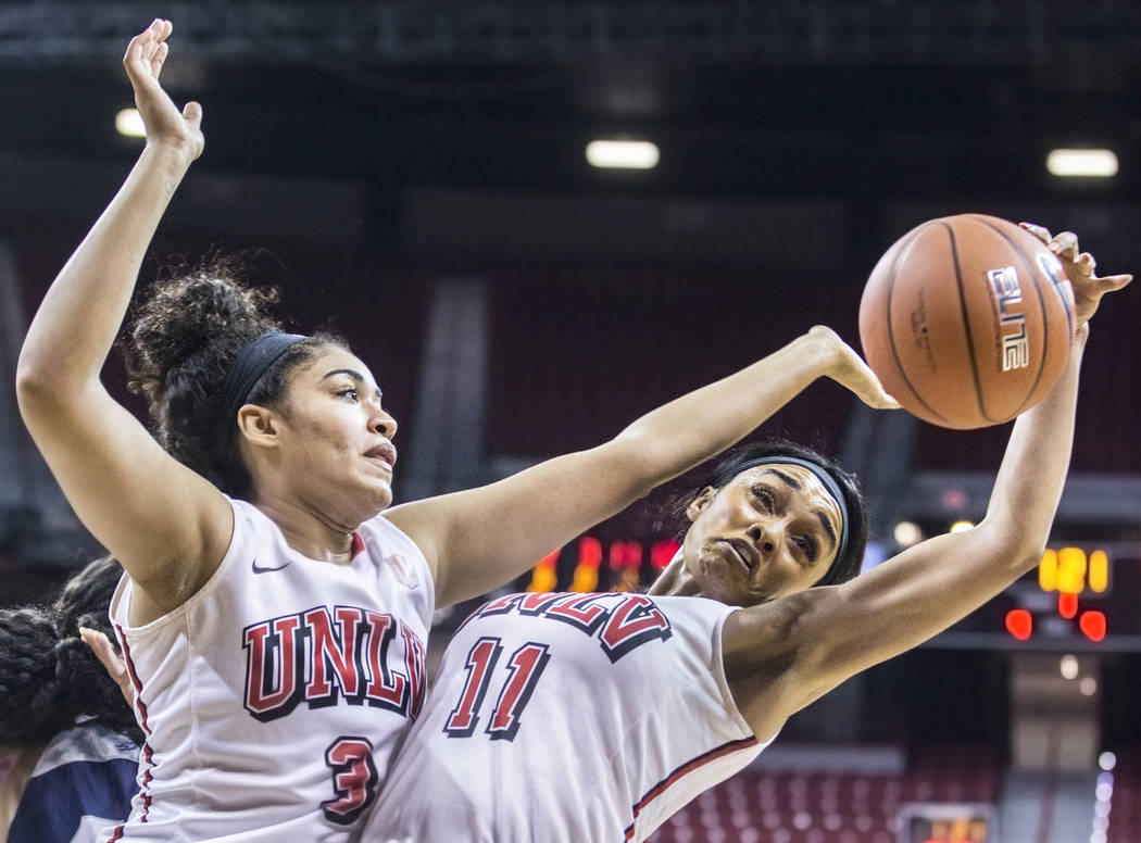 UNLV's Dylan Gonzalez (11) and Paris Strawther (3) fight for rebound during the second round of the Mountain West tournament on Tuesday, March 7, 2017, at Thomas & Mack Center, in Las Vegas.   ...