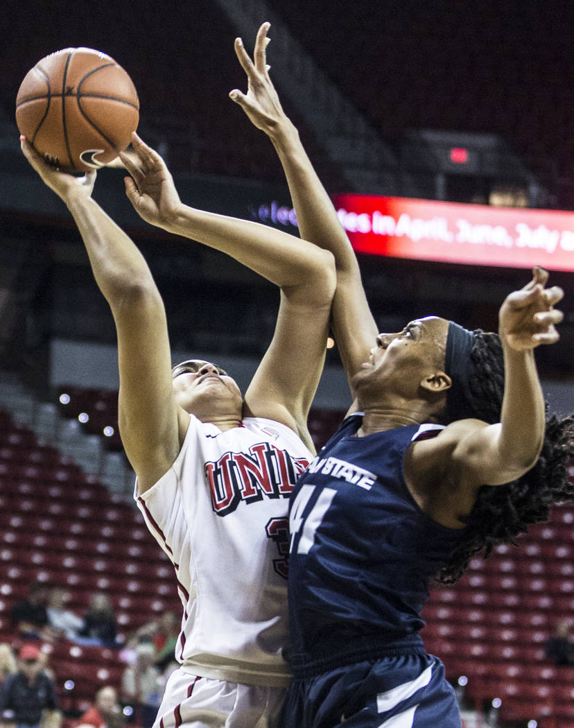 UNLV's Paris Strawther (3) drives to the basket over Utah State's Antoina Robinsonson (41) during the second round of the Mountain West tournament on Tuesday, March 7, 2017, at Thomas & Mack C ...