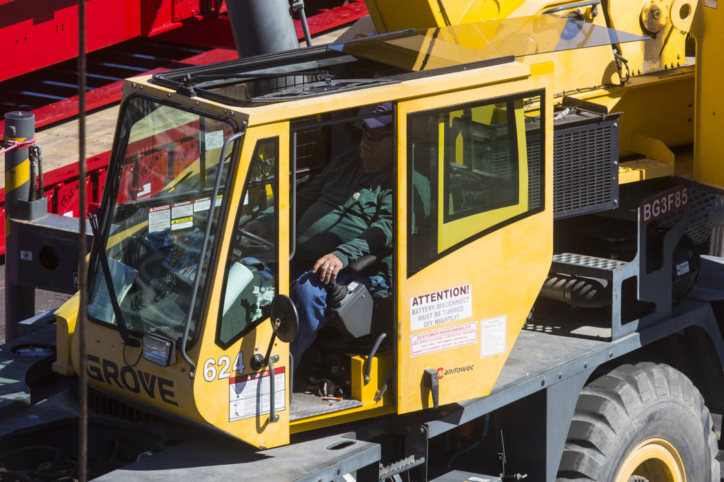 A man operates heavy equipment while setting up ahead of the ConExpo-Con/Agg construction equipment trade show at the Las Vegas Convention Center in Las Vegas, Wednesday, March 1, 2017. The show w ...