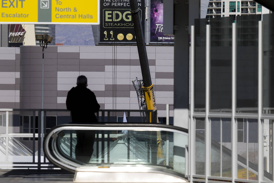 A man leaving the Las Vegas Monorail observes various construction equipment going up ahead of the ConExpo-Con/Agg trade show at the Las Vegas Convention Center in Las Vegas, Wednesday, March 1, 2 ...