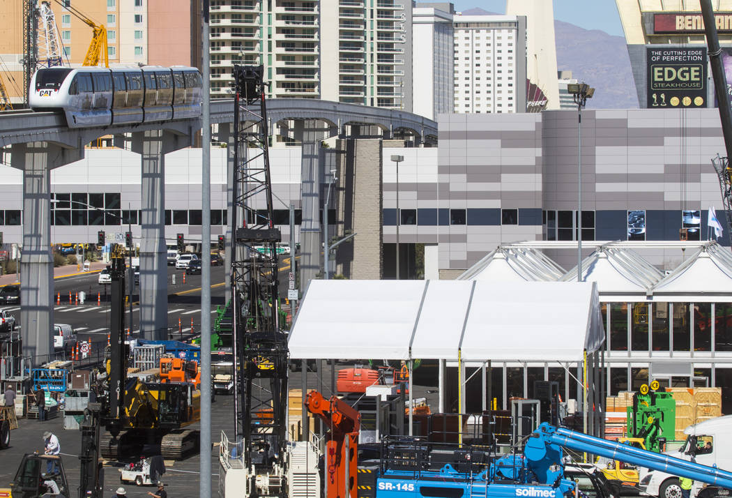The Las Vegas Monorail drives past various construction equipment going up ahead of the ConExpo-Con/Agg trade show at the Las Vegas Convention Center in Las Vegas, Wednesday, March 1, 2017. The sh ...