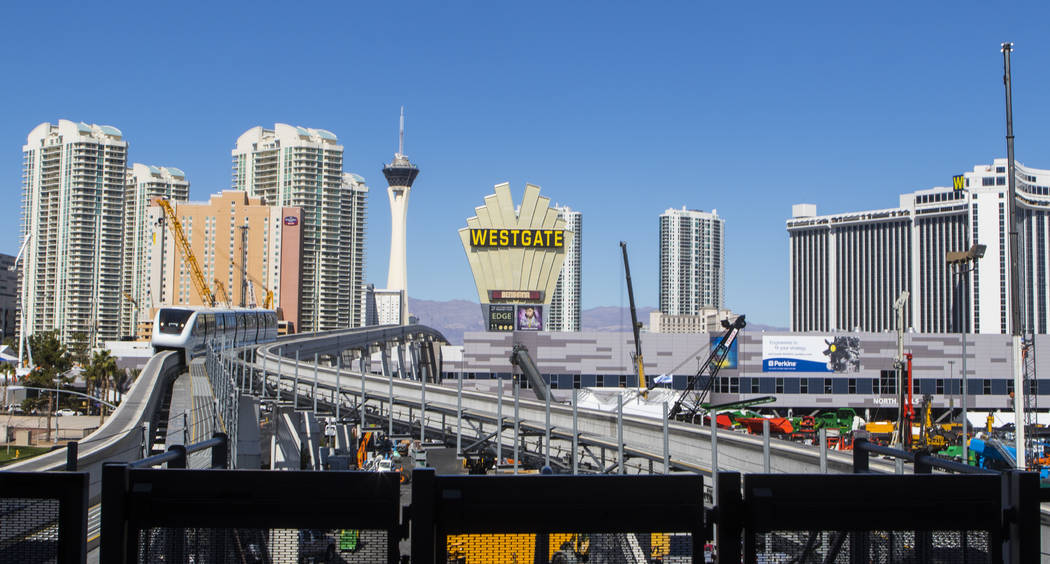 The Las Vegas Monorail moves past various construction equipment going up ahead of the ConExpo-Con/Agg trade show at the Las Vegas Convention Center in Las Vegas, Wednesday, March 1, 2017. The sho ...