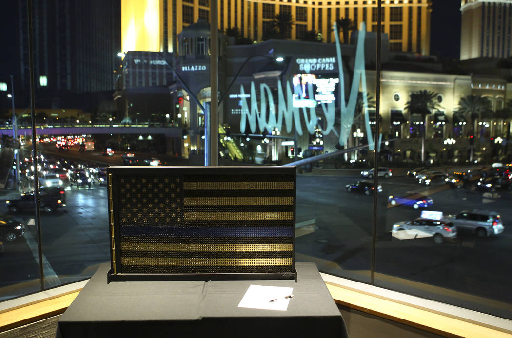 """America Supports the Blue "" by Las Vegas police officer Darryl McDonald during the Cops and Canvas fundraising event for the Metropolitan Police Department at Neiman Marcus insi ..."