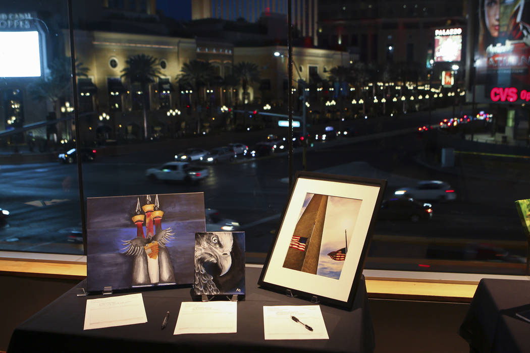 Art pieces are displayed during the Cops and Canvas fundraising event for the Metropolitan Police Department at Neiman Marcus inside of the Fashion Show Mall in Las Vegas on Thursday, March 2, 201 ...