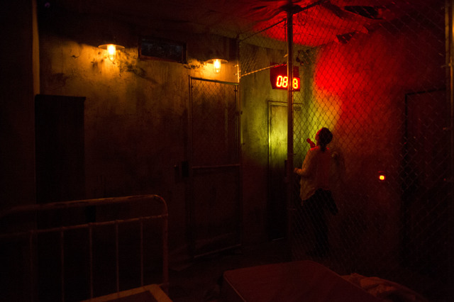 Tori Young, a participant at The Basement escape room, checks the clock during a recent game. Teams have 45 minutes to find clues and solve puzzles to escape the basement of a hypothetical serial  ...