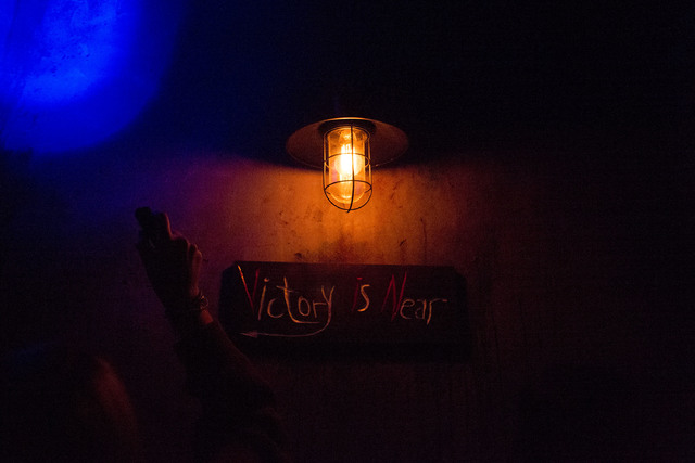 "A sign reads ""Victory is Near"" at The Basement. The premise of the game is that participants have been kidnapped by a cannibalistic serial killer, and they must escape his basement or face certain ..."